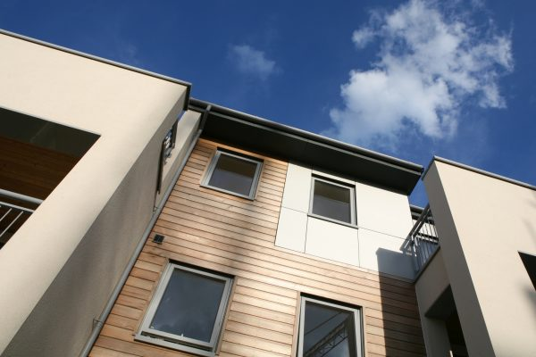 Smart modern low-rise apartments with softwood and aluminium cladding.